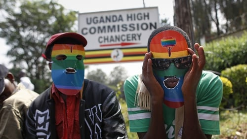 Masked Kenyan supporters of the LGBT community stage a protest against Uganda's anti-gay bill