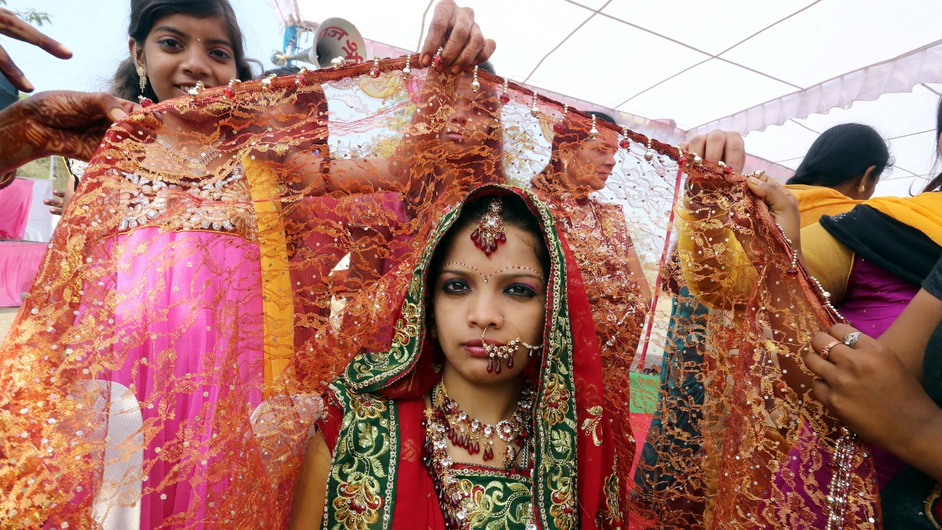 A bride takes part in a mass marriage ceremony organised for underprivileged couples in Bhopal, India