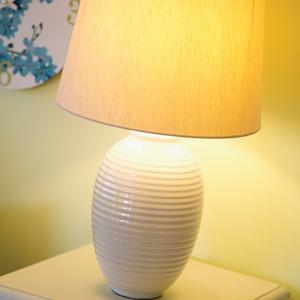 Ribbed ceramic lamp €25, printed wall clock €6