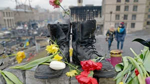 A pair of boots placed as a memorial to an anti-Yanukovych protester who was killed in clashes with riot police in Kiev last week