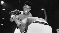 Cassius Clay shocks champion Sonny Liston to take heavyweight crown