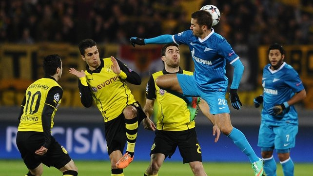 Zenit Saint Petersburg's Viktor Fayzulin (2nd right) vies with Borussia Dortmund's Nuri Sahin (2nd left) and Sokratis Papastathopoulos (centre)