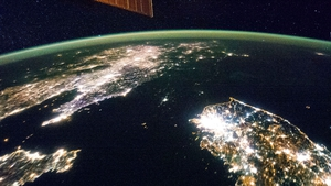 A handout from NASA shows most of the Korean peninsula and China at night, with a sparsely lit North Korea in the centre (Pic: EPA)