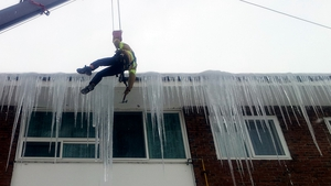 Firefighters of Taebaek Fire Station in South Korea remove big icicles from roofs in the eastern province of Gangwon (Pic: EPA)