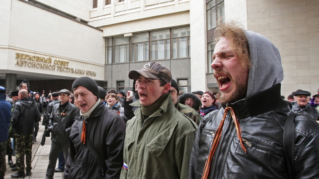 Pro-Russian activists stand in line in front of the Parliament building during Crimean Tatar protest (Pic: EPA)
