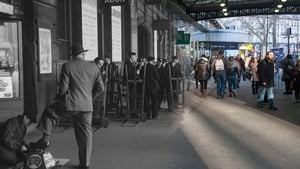 1950 - Boy shining shoes outside the Tea Room at Victoria station. A group of porters can be seen with their trolleys waiting to help travellers with their luggage (Pic: Henry Grant Collection/Museum of London)