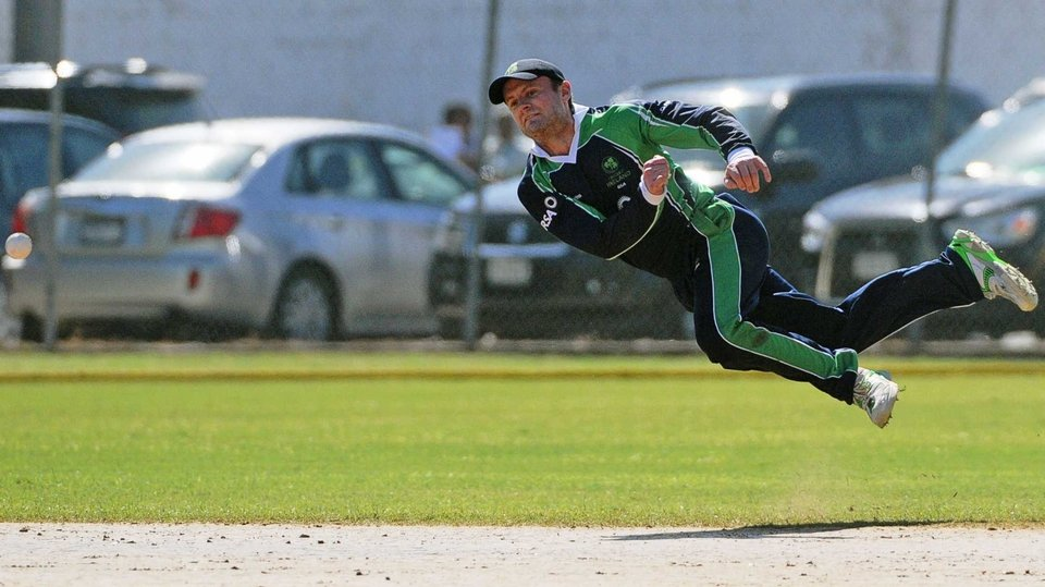 Ireland's William Porterfield dives for a ball against the West Indies