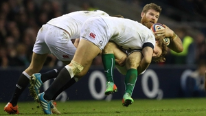 Ireland's Gordon D'Arcy is tackled by England's Billy Twelvetrees