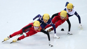 Kexin Fan of China, Suk Hee Shim of South Korea, Jianrou Li of China and Elise Christie of Great Britain compete in the Short Track Women's 1000m speed skating