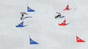 Alexander Bergmann of Germany and Aaron March of Italy compete in the Snowboard Men's Parallel Slalom