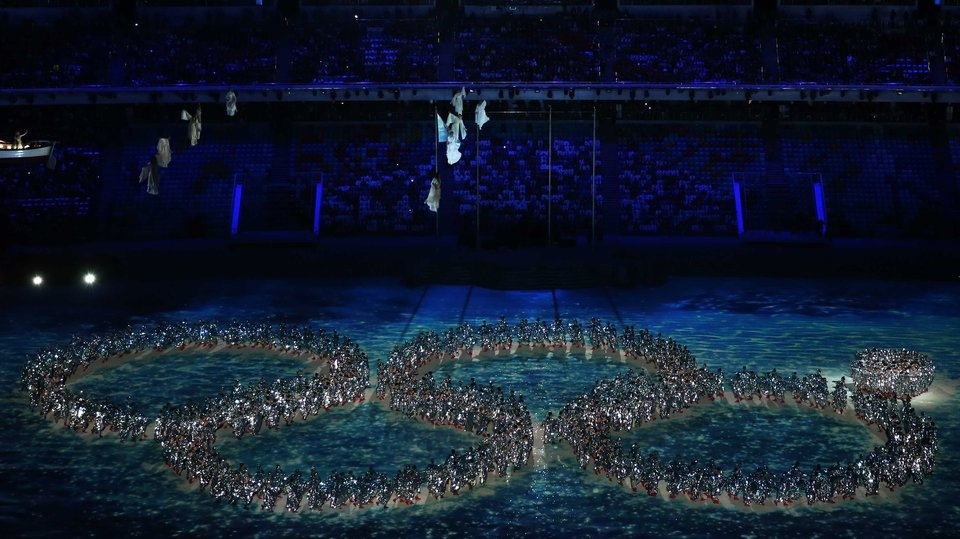 Dancers re-enact the Opening Ceremony ring failure during the 2014 Sochi Winter Olympics Closing Ceremony