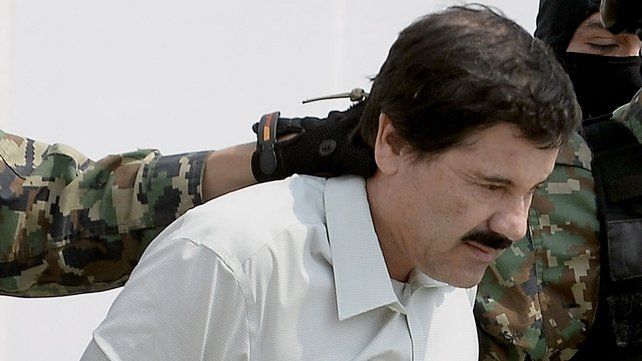 Mexican drug trafficker Joaquin Guzman Loera aka 'el Chapo Guzman', is escorted by marines as he is presented to the press