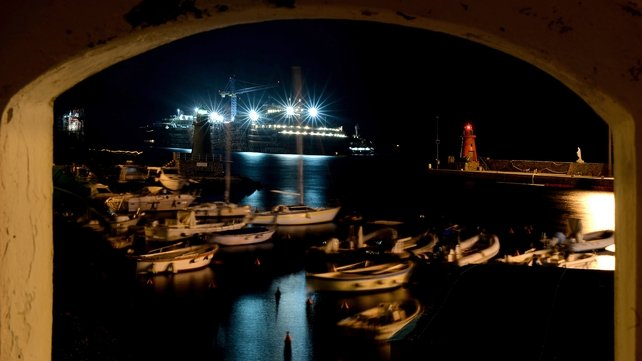 The wreckage of the Costa Concordia is seen in the harbour of Giglio Porto