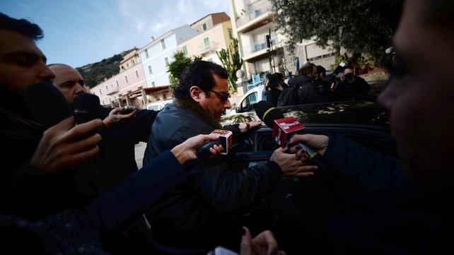 Captain Francesco Schettino was surrounded by media as he arrived at a hotel in Giglio Porto