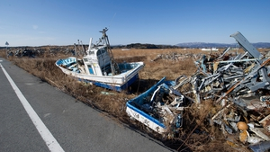 Tsunami debris in the restricted nuclear evacuation zone in the nuclear ghost town of Namie, 17km from the Fukushima nuclear power plant