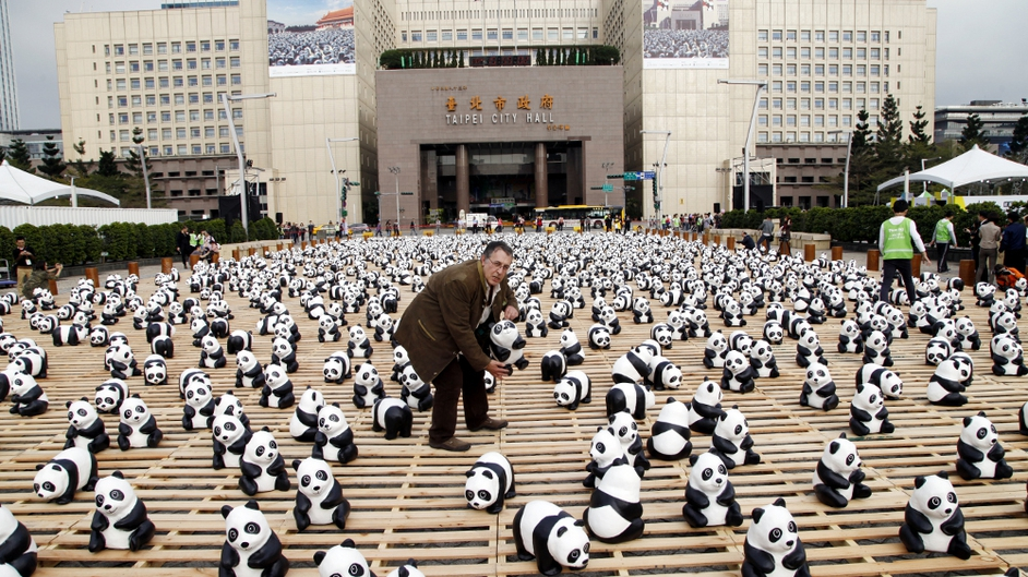 French paper-marche artist Paulo Grangeon launches his 'Pandas on Tour' show in Taipei (Pic: EPA)