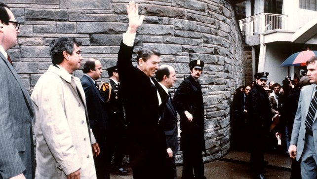 Ronald Reagan seen waving to the crowd just before the assassination attempt on him