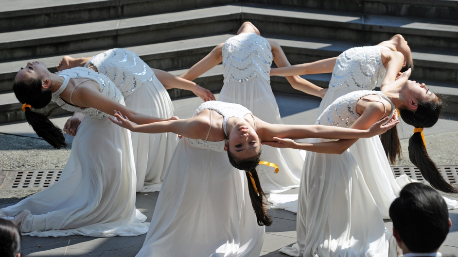 Dancers perform at the Taipei Peace Park during the anniversary of a 1947 massacre during which thousands were killed by nationalist Kuomintang troops from China