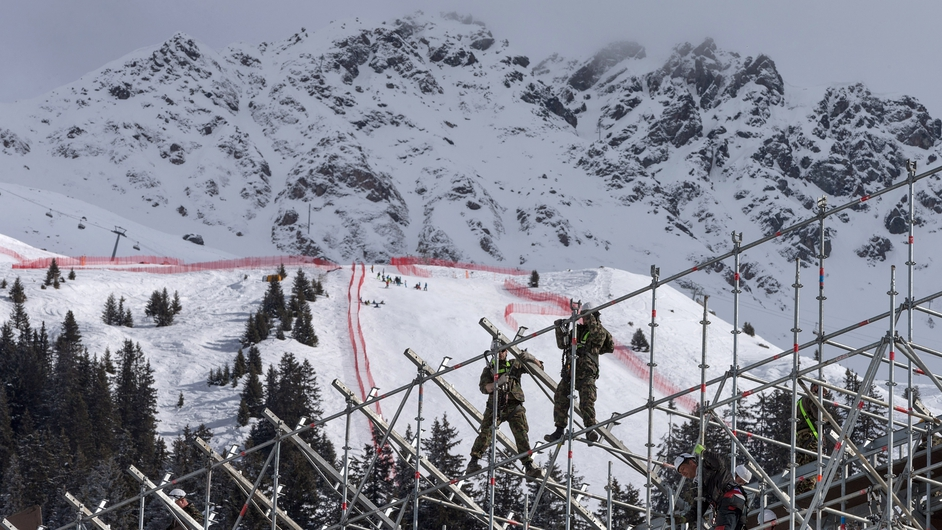 Swiss Army personnel mounting the stands in the finish area for the alpine skiing FIS World Cup Final races, in Lenzerheide-Parpan