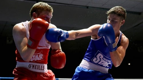 Michael Nevin (blue) caused an  upset with victory against Ray Moylette in the  light-welterweight division
