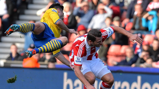 Arsenal's Olivier Giroud is tackled by Stoke's Erik Pieters