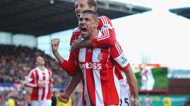 Jonathan Walters celebrates after scoring a penalty against Arsenal