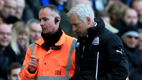 Alan Pardew is escorted off the pitch after being shown a red card