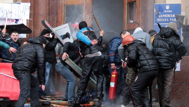 Pro-Russian activists clash with Maidan supporters as they storm a government building in Kharkiv