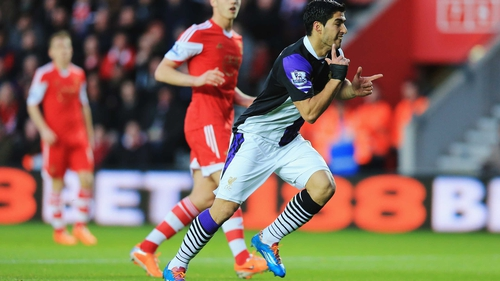 Luis Suarez opened the scoring for Liverpool