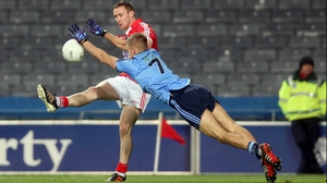 Dublin's Johnny Cooper and John Hayes of Cork in action at Croke Park again