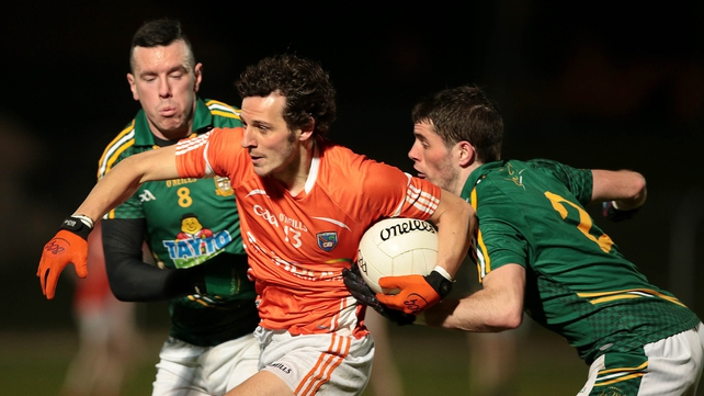 Armagh's Jamie Clarke escapes the clutches of Meath's Andrew Tormey and Donal Keoghan