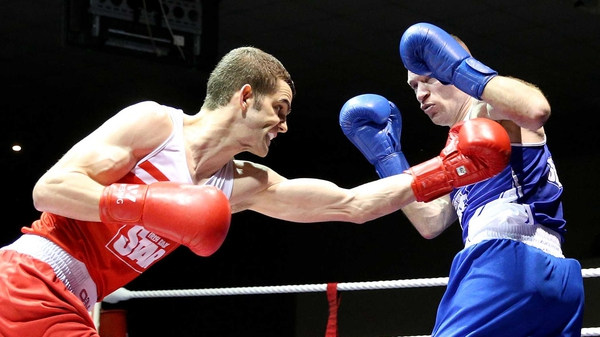 Adam Nolan lands a blow on Fergal Redmond