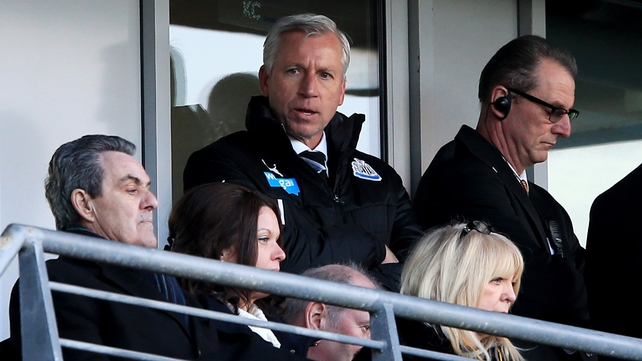 Alan Pardew watches on from the stands after the headbutting incident