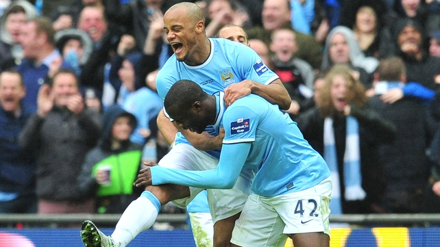Vincent Kompany celebrates with Yaya Toure's after Toure's stunning goal for Man City