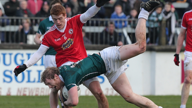 Kildare's Tomas O'Connor tackled by Peter Harte in Newbridge