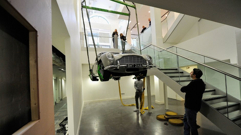 An Aston Martin DB5 used in the film Goldeneye is loaded in to the London Film Museum ahead of the Bond in Motion exhibition