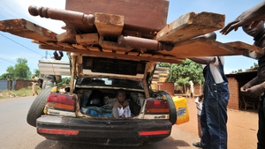 Men check a loaded car at a Christian 'anti-balaka' checkpoint in Bangui's PK12 area in the Central African Republic