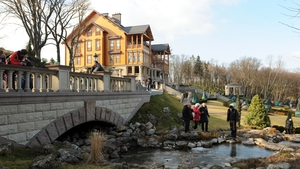 Visitors walk near the luxury residence, located near Kiev