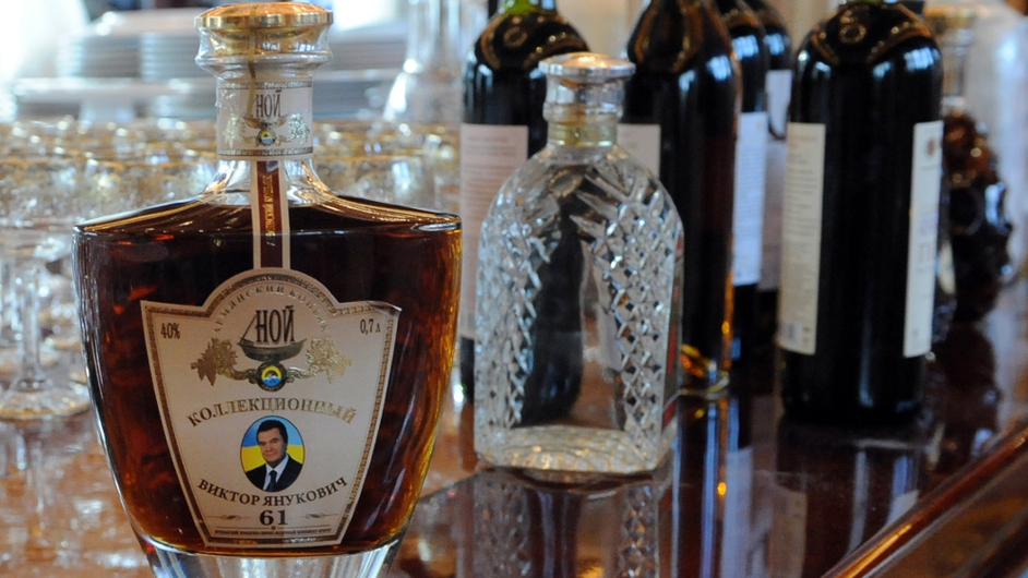 A bottle of brandy features an image of the ousted president