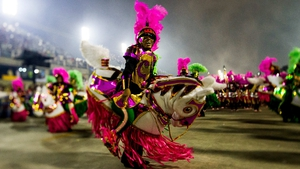 Members of Mangueira Samba School celebrate during their parade at the Carnival in Rio, captured with a tilt-shift lens