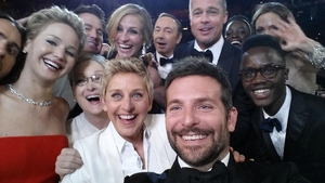 A 'selfie' taken by Bradley Cooper with Oscars host Ellen DeGeneres and stars including Meryl Streep, and Jennifer Lawrence quickly became the most shared photo ever on Twitter