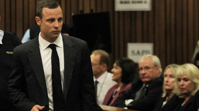 Oscar Pistorius enters the courtroom ahead of his trial (Pic: EPA)