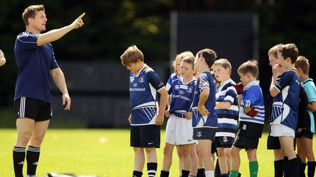 Brian O'Driscoll trains a group of young rugby players