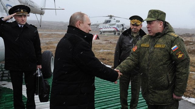 Vladimir Putin shakes hands with Commander of the Western Military District Anatoly Sidorov