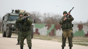 Pro-Russian forces fired warning shots during a standoff with Ukrainian soldiers in Crimea