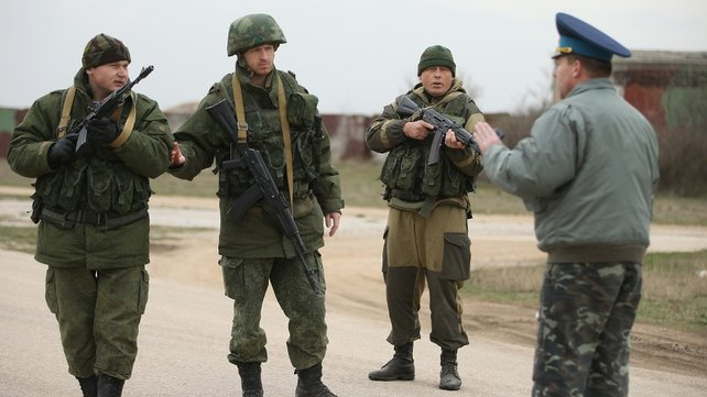 Colonel Mamchor speaks to the Russians in a tense standoff at the Belbek base