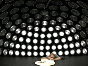 This photo was taken of a researcher under Ireland's only artificial sky. He is studying the internal visual environment in an architectural model under 145 individually controlled lamps (Pic: Paul Kenny)