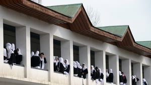 Kashmiri college students gather for classes on the first day of the schooling session at Women's College in Srinagar