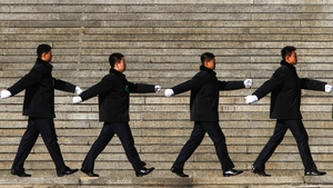 Plain clothes security officers walk on the steps outside the Great Hall of the People in Beijing (Pic: EPA)