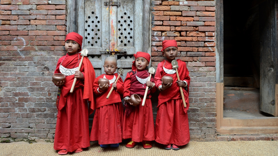 A group of Nepalese Buddhist boys pose as they attend Bratabandha, a coming-of-age ceremony in Kathmandu